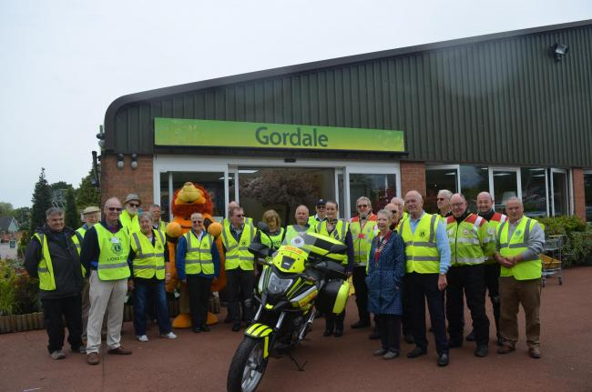 Representatives from the six Lions Clubs with the new motorcycle and volunteers of the Merseyside and Cheshire Blood Bikes