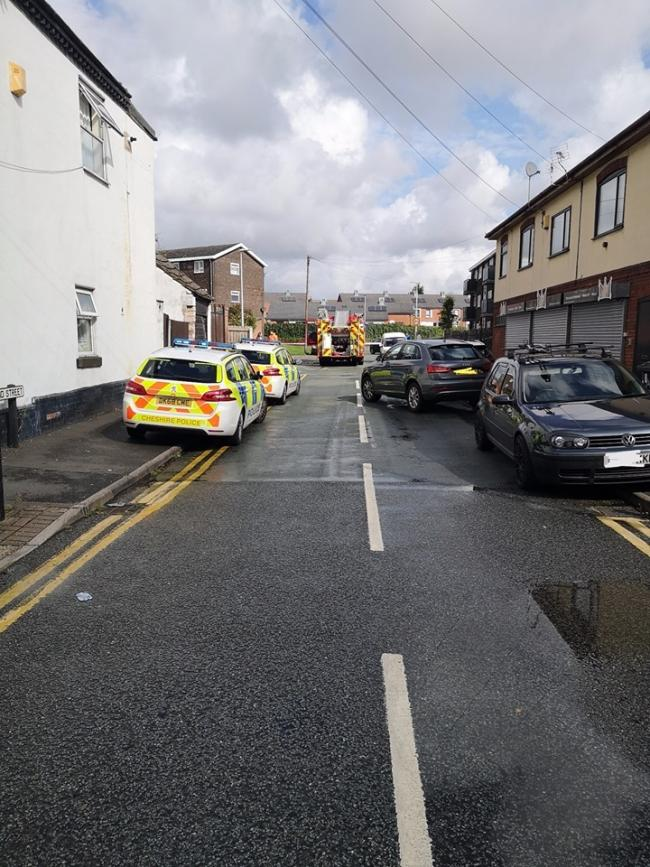 Police and a fire engine on Norland Street in Widnes this morning, Sunday