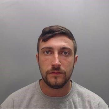 Adam Hodgson is wanted in connection with an assault and failing to appear in court (Cheshire Police)