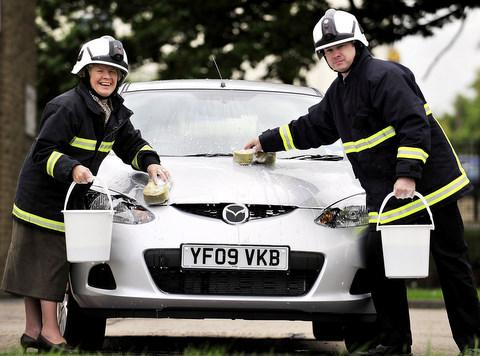 Firefighters urge drivers to support their charity car wash