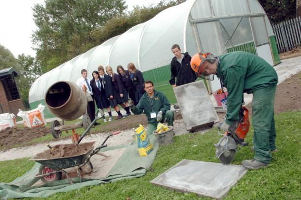 Bankfield pupils build a polytunnel with help from Mel Lowe, centre, and Adam Poulton Picture: Dave Gillespie DGH170909