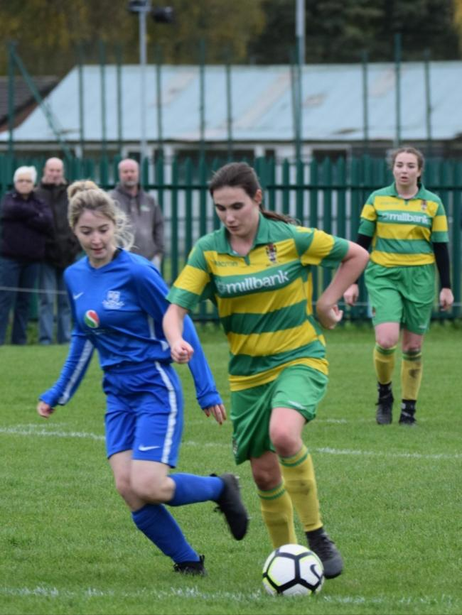 Opening goal scorer Jess Bazley takes the Linnets forward, watched by captain Becky Barker. (Photo Neil Thornton).