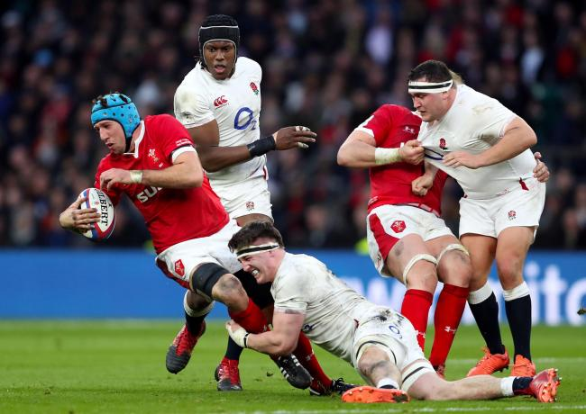 Wales' Justin Tipuric (left) is tackled by England's Tom Curry (centre) during the Guinness Six Nations match at Twickenham. Photo Picture: David Davies/PA Wire.