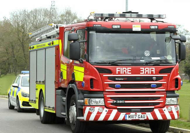 Four fire engines have been dispatched to Runcorn as firefighters tackle a garage fire
