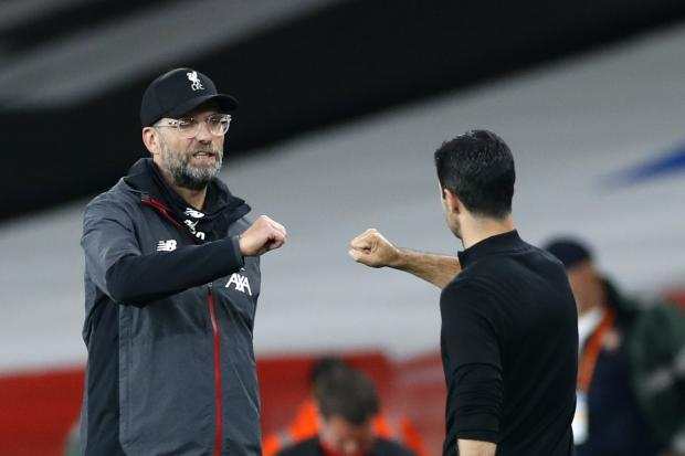 Liverpool manager Jurgen Klopp, left, and Arsenal head coach Mikel Arteta