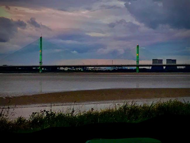 The Mersey Gateway Bridge, snapped from Wigg Island, goes green for the #GoGreenForParks campaign
