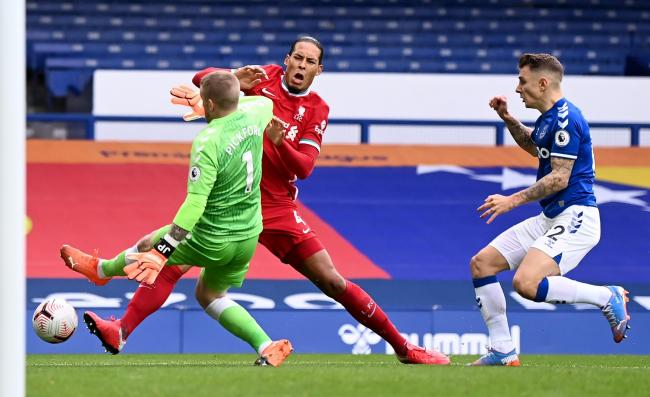 Liverpool defender Virgil Van Dijk will see a consultant on Sunday with the club concerned about a knee injury sustained in the Merseyside derby