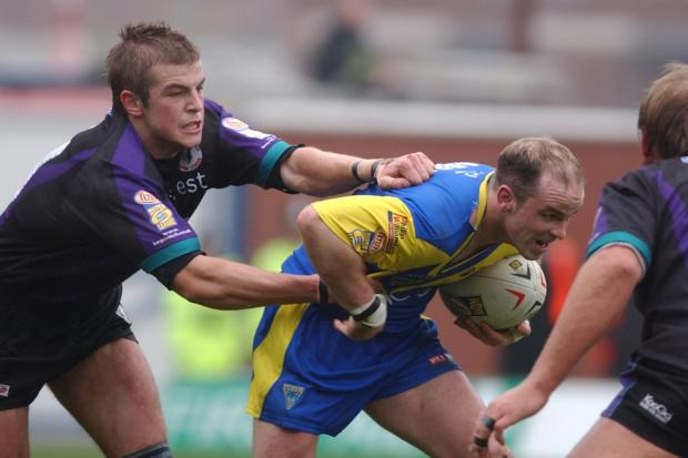 Stephen Myler tackles Warrington's Daryl Cardiss in 2004. Picture: Dave Gillespie