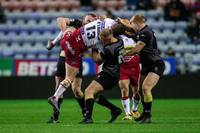 Toronto Wolfpack tackling Wigan earlier this season. picture: SWpix.com