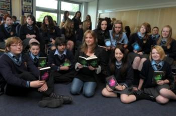 Author Julie Bertagna with gifted and talented year 9 students at SS Peter & Paul RC College Picture: Dave Gillespie DGF090611