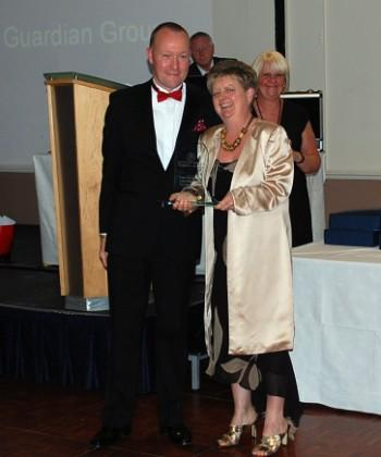 Halton Haven trustee Neil Townsend presents Barbara Jordan with the Media Support Award