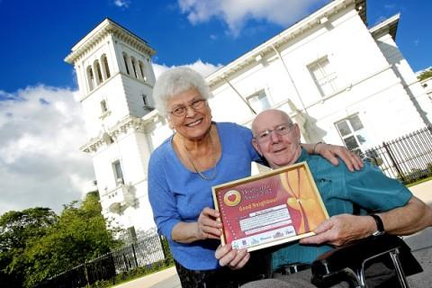 Jim Rotheram, aged 80, of Windmill Hill, winner of the Good Neigjhbour award with his wife, Jean, outside Runcorn Town Hall