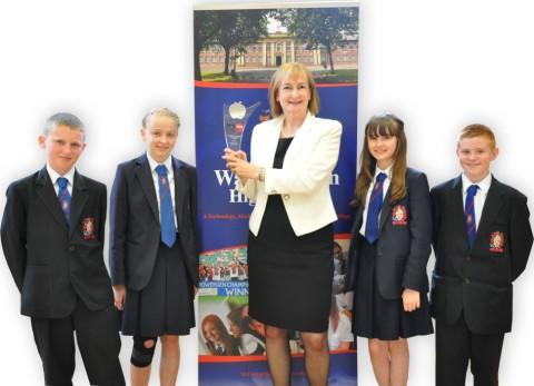 From left, Executive head teacher Pamela Wright with, from left, pupils Ben Smith, Daisy Gibbins, Eleanor Oulton and Jordan Wilson