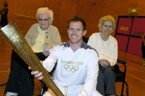 Olympic torchbearer Gavin Hanson with Winnie Williams and Eileen Mannion Picture: Ian Park IPX6712