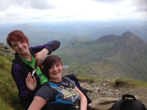 Paula Robinson cuts her sister-in-law Adele's hair on top of Mount Snowdon