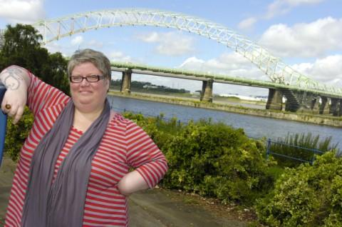 02 ambassador, Karen Ripley beside the Silver Jubilee Bridge