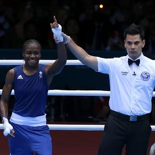 Nicola Adams, left, is guaranteed at least a silver medal after advancing to the final