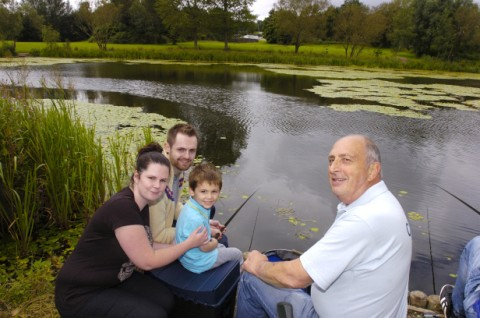Kerry Teachen, Nigel Teachen, and Brendan Kane, are shown how to fish by Frank Lythgoe from Warrington Anglers Association