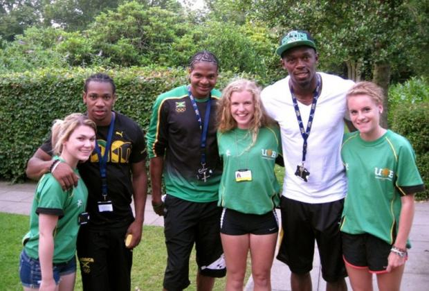 Sarah with Usain Bolt, Yohan Blake and Jermaine Gonzales