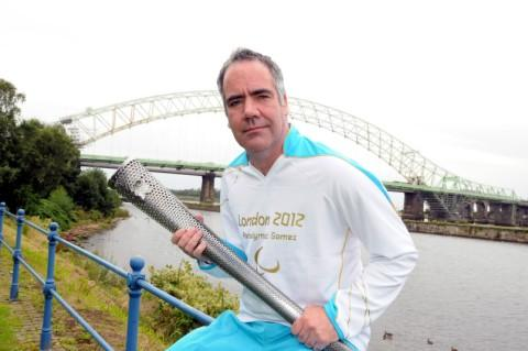 Mark Allen with his Paralympic torch