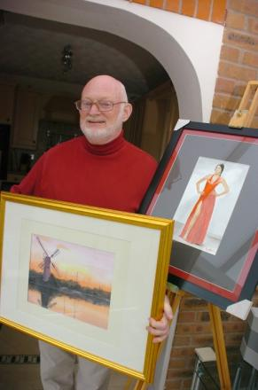 Ken Allen with some of his paintings