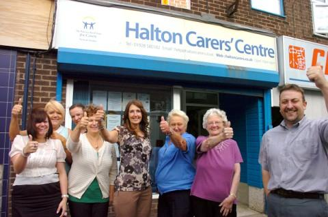 Runcorn and Widnes World: Carl Harris, manager of Halton Carers Centre and staff celebrate receiving their lottery award