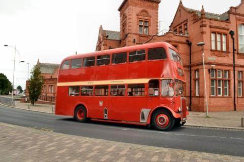 This vintage bus will offer free rides to the rally