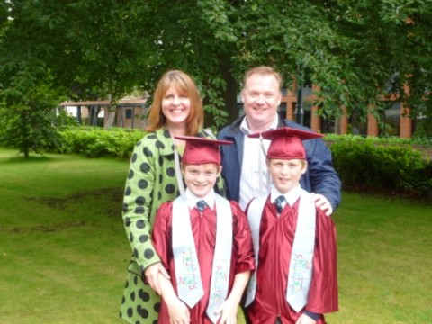Rachael and Neale Vickery and their twin sons, Ryan and Jake graduating at Hope University from an after school at Holy Family School in Cronton
