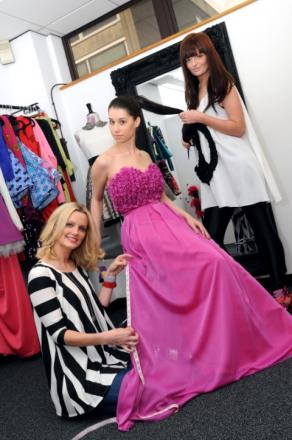 Natalie Beard, left, and Lisa Campbell prepare a model for the fashion show