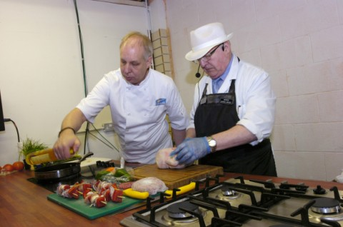 Celebrity chef Mike Harrison demonstrates at Widnes Market with butcher Peter Kelly
