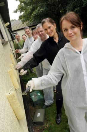 Halton Housing Trust painters, from front, Laura Beckett, Emma Woolstonholme, Scott Haspell, Amber Cairns, Tony Wylie, Liz Batty and Phil Sixsmith