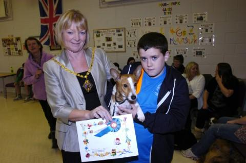 The Mayoress of Halton, Clr Angela McInerney, presents Alex Carter Carter and his dog, Pip, with a prize for having the brightest eyes