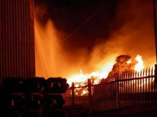 Firefighters still at warehouse blaze