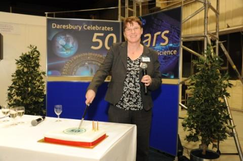 Susan Smith, head of Daresbury Laboratory, cuts a 50th anniversary cake