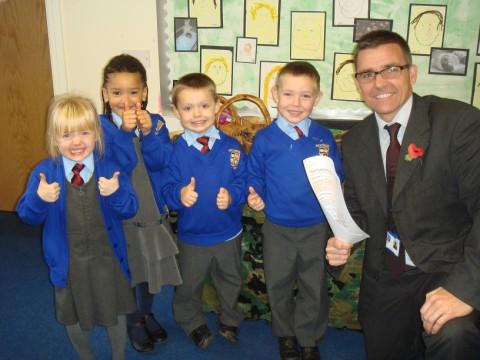 Head teacher Andy Williams with reception pupils,  Caitlin Yates, Evie Kanoyangwa, Jack Campbell, Fraser Dodd