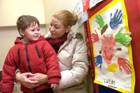 Three-year-old Lucas Wilkinson shows his art work to his mum, Kerry