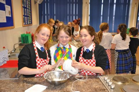 Chloe Charlesworth,Tia Condron and Megan Ashton making cakes