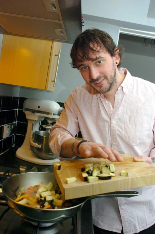Runcorn and Widnes World: Toby Dunne prepares a tasty stir fry