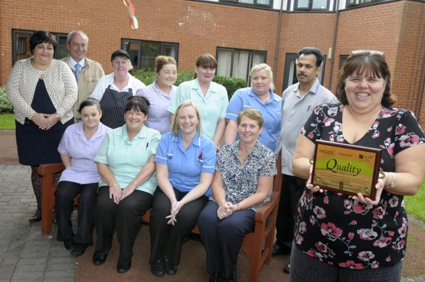 Sue Ashcroft, manager at St Luke's, with staff from the care home and Halton Haven Hospice