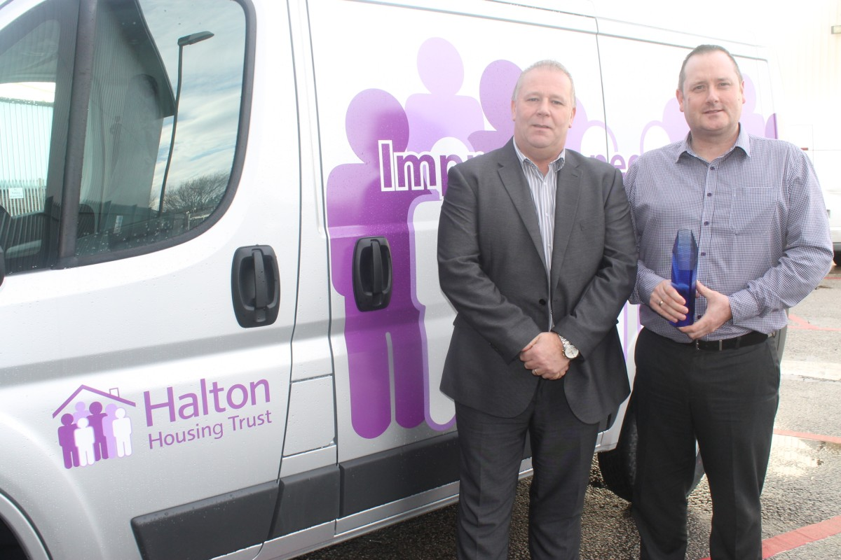 Halton Housing Trust staff John Maddox and Paul Carson with the award