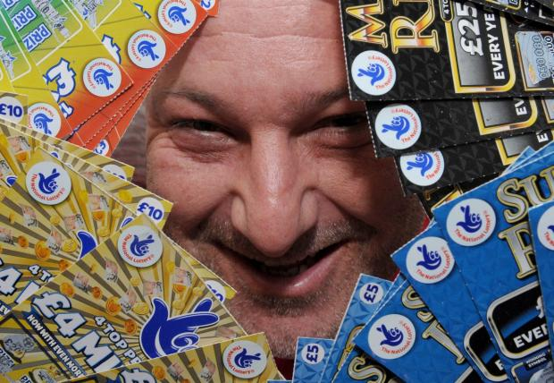 Dave Mannix with some of his scratchcards