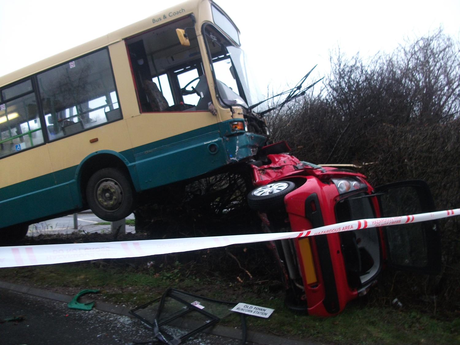 Firefighters treated casualties after a bus and car collided in Runcorn