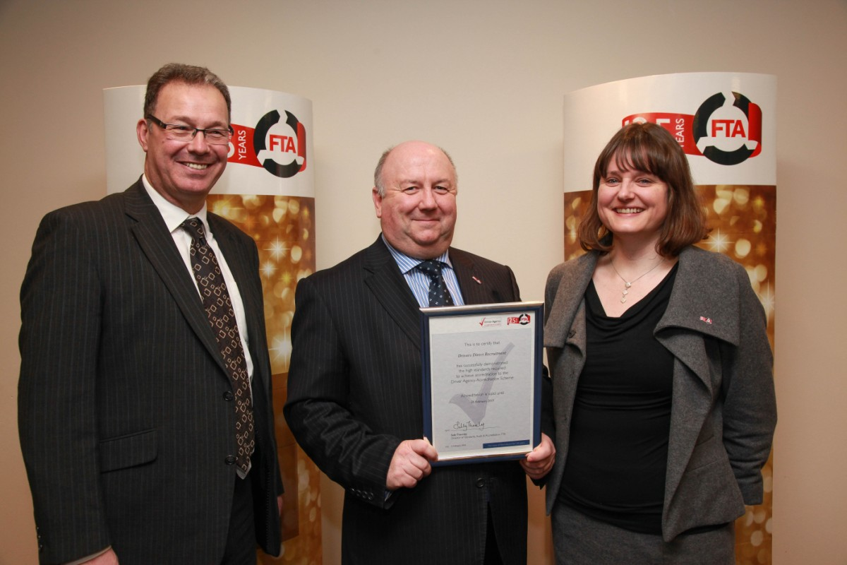 Gethin Roberts, managing director of Drivers Direct (centre) with Sally Thornley, director of standards,