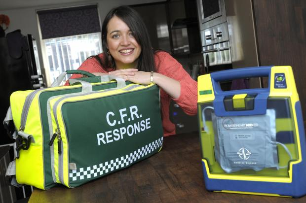 First responder Caroline McDonnell with her lifesaving equipment