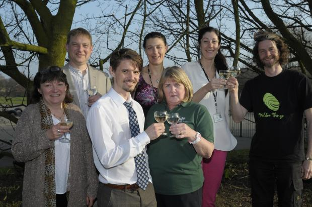 Rob Moore, Sue Green, Jill Hewett, Nigel Balding, Kate Kerr, Marie Bell and Tim Kirwin celebrate the success of the woodland project at Brookvale Primary School
