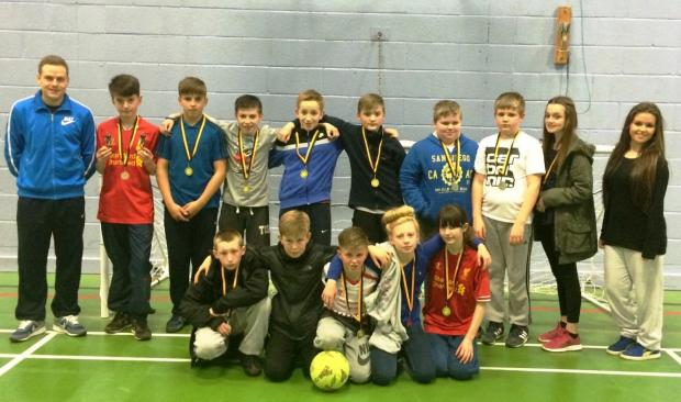 Youngsters celebrate the grand final of their Brazian World Cup themed soccer camp