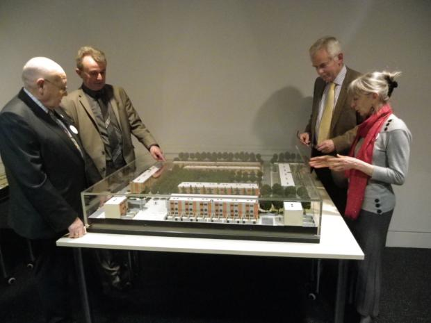 Halton Clrs Dave Cargill and Ron Hignett discuss the newly restored model of Southgate with Professor Peter Batey, Liverpool University, and Carol Davenport, a former town planner for Runcorn Development Corporation