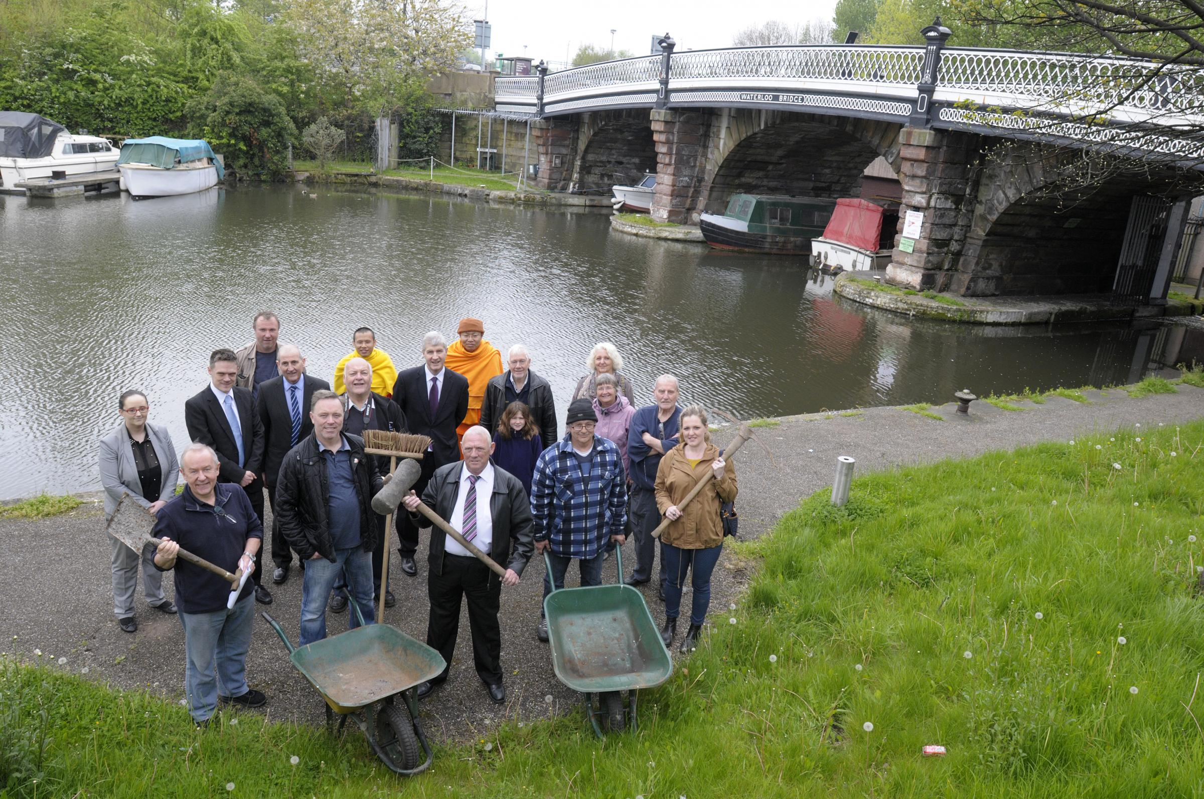 Halton MP Derek Twigg joins Noel Hutchinson and campaigners at the site of the proposed new locks