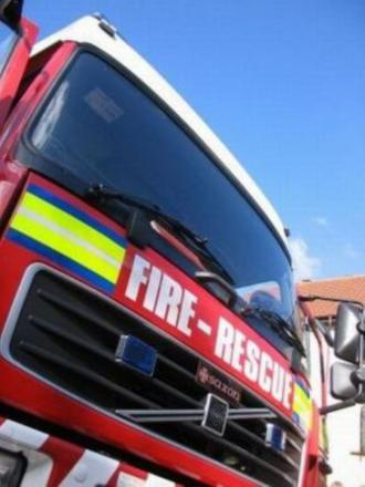Firefighters tackle a flat fire in Runcorn