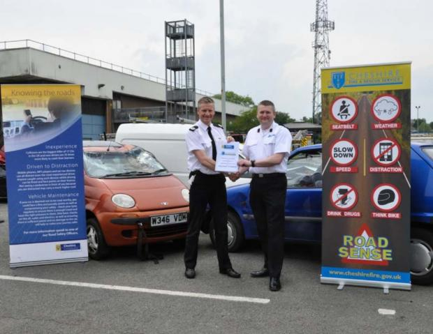 Assistant Chief Constable Guy Hindle (left) with Deputy Chief Fire Officer Mark Cashin and the Cheshire memorandum of understanding for road Safety